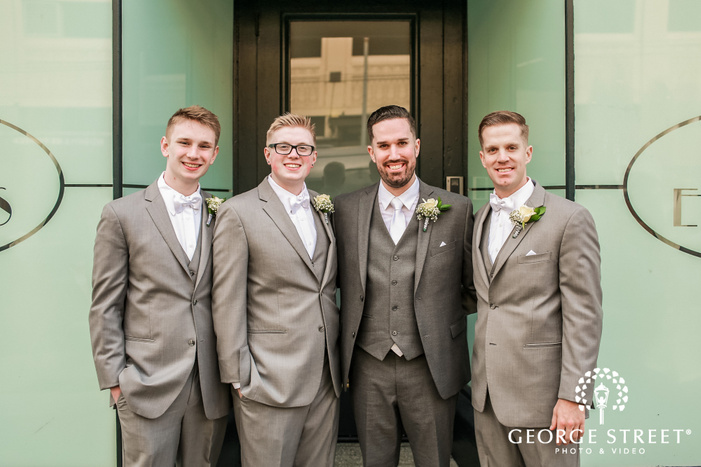 charming groom and groomsmen in front of      events in seattle