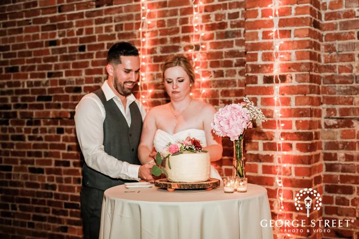 cute couple cake cutting ceremony wedding photo