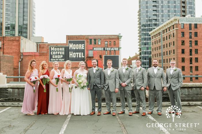 elegant couple and group on rooftotp wedding photo