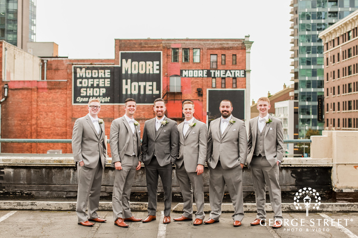 handsome groom and groomsmen on rooftop at      events in seattle