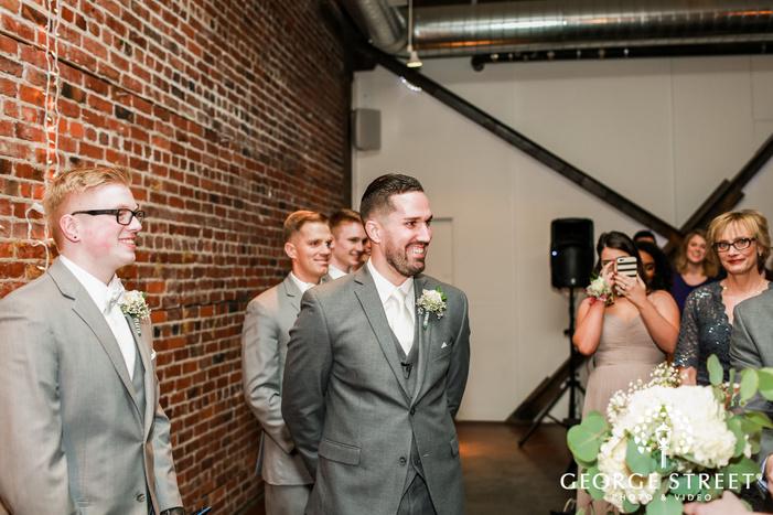 handsome groom first look wedding photo