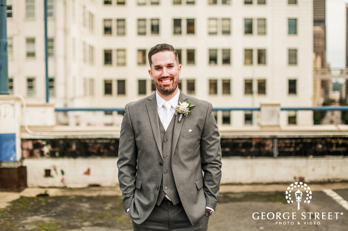 handsome groom on buidling terrace wedding photo