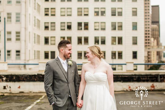 happy bride and groom on rooftop wedding photo