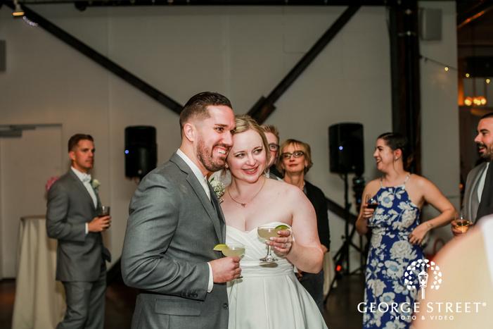 joyful bride and groom during reception speech wedding photo