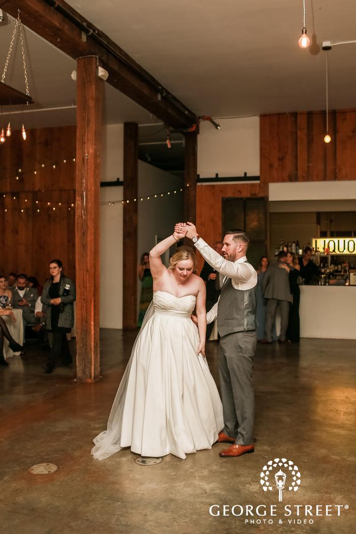 joyful bride and groom first dance wedding photography