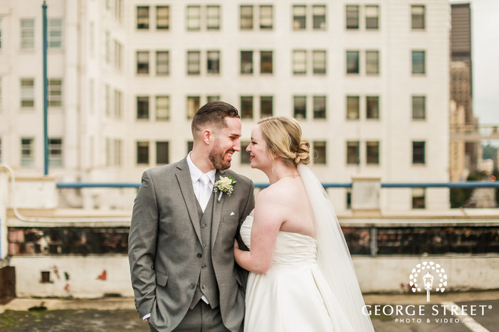 loving bride and groom on rooftop wedding photos