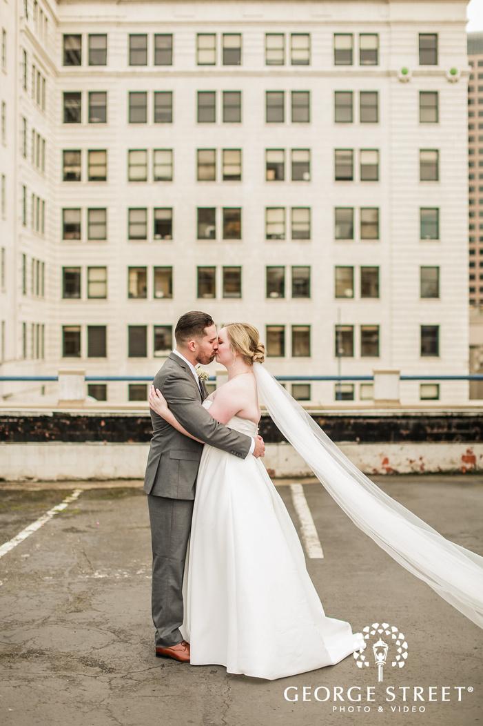 romantic couple on building rooftop wedding photo