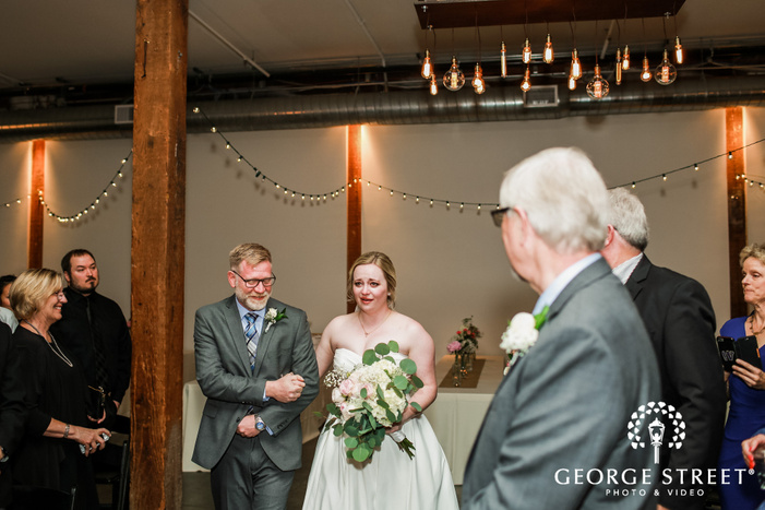 sweet bride and father walking down the aisle wedding photo