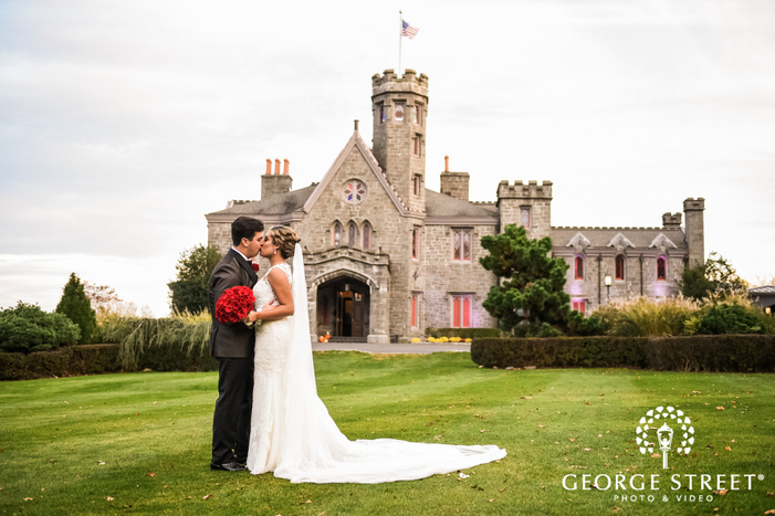 charming bride and groom in front of castle wedding photo