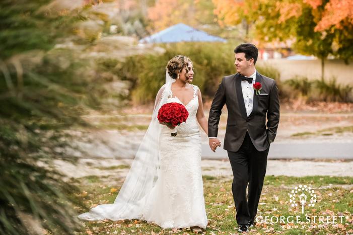 gorgeous bride and groom walking in yard