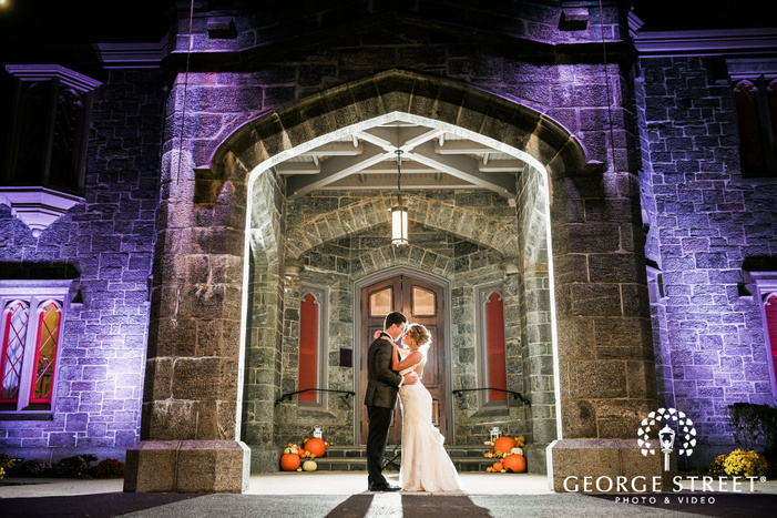 lovely bride and groom in front of fortress