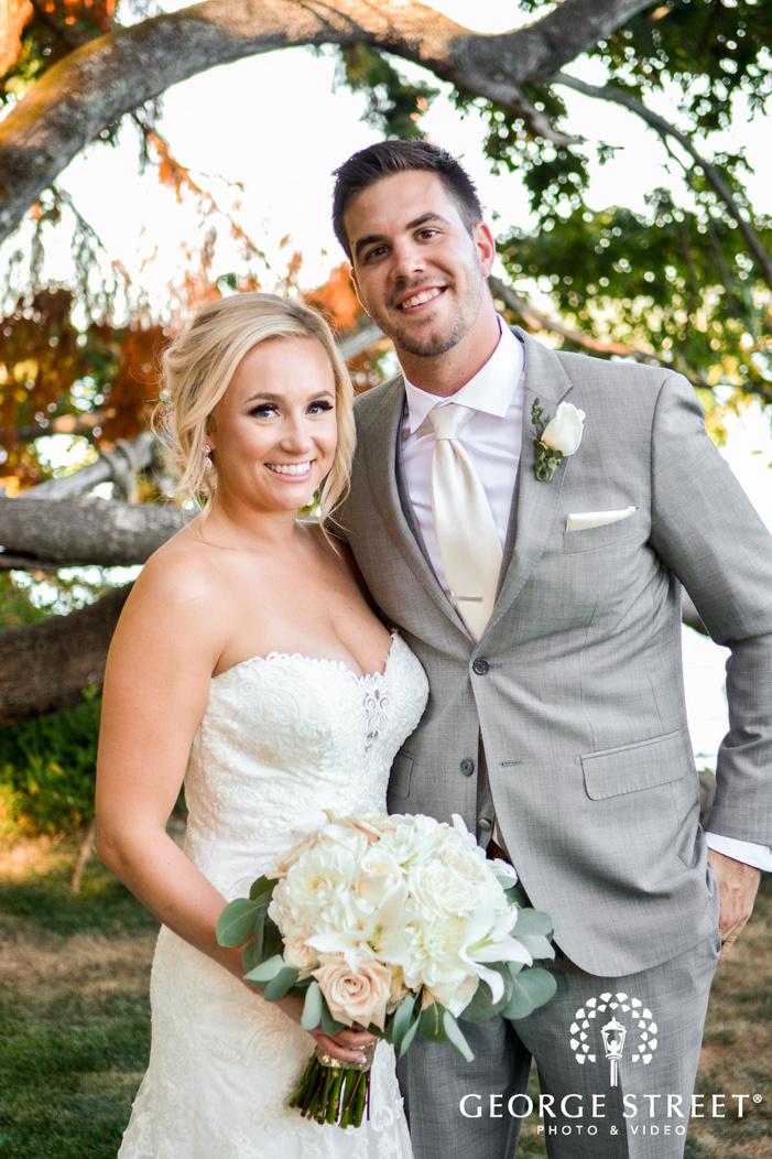 good looking bride and groom in garden