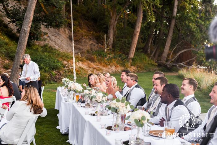 joyful bride and groom during reception toast