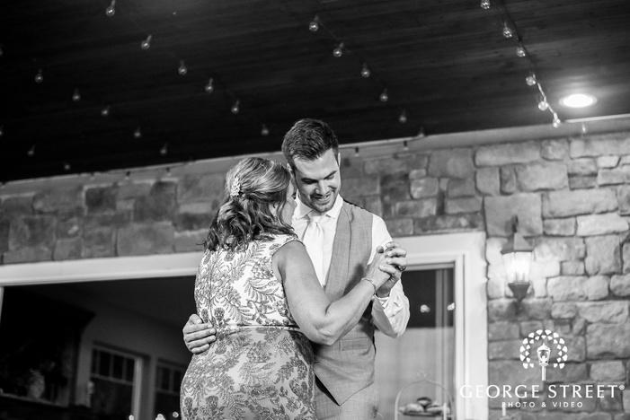 joyful groom and mother reception dance