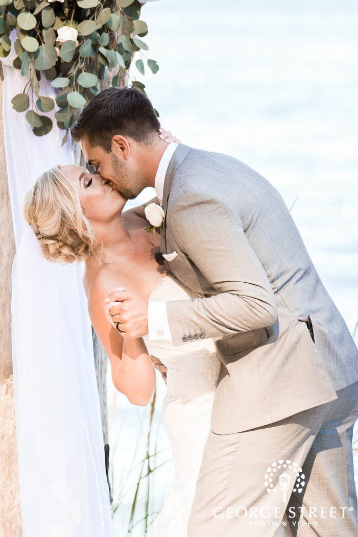 lovable bride and groom first kiss