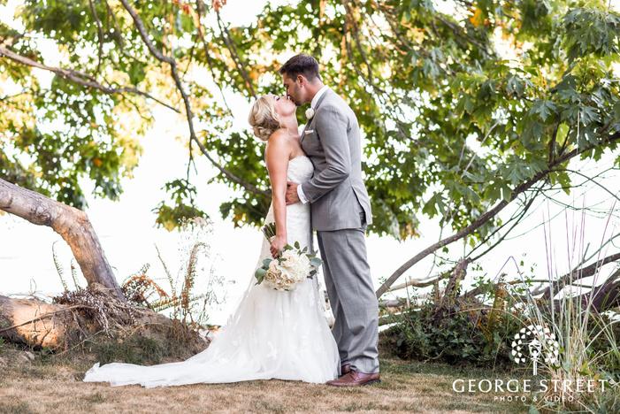 lovable bride and groom in yard