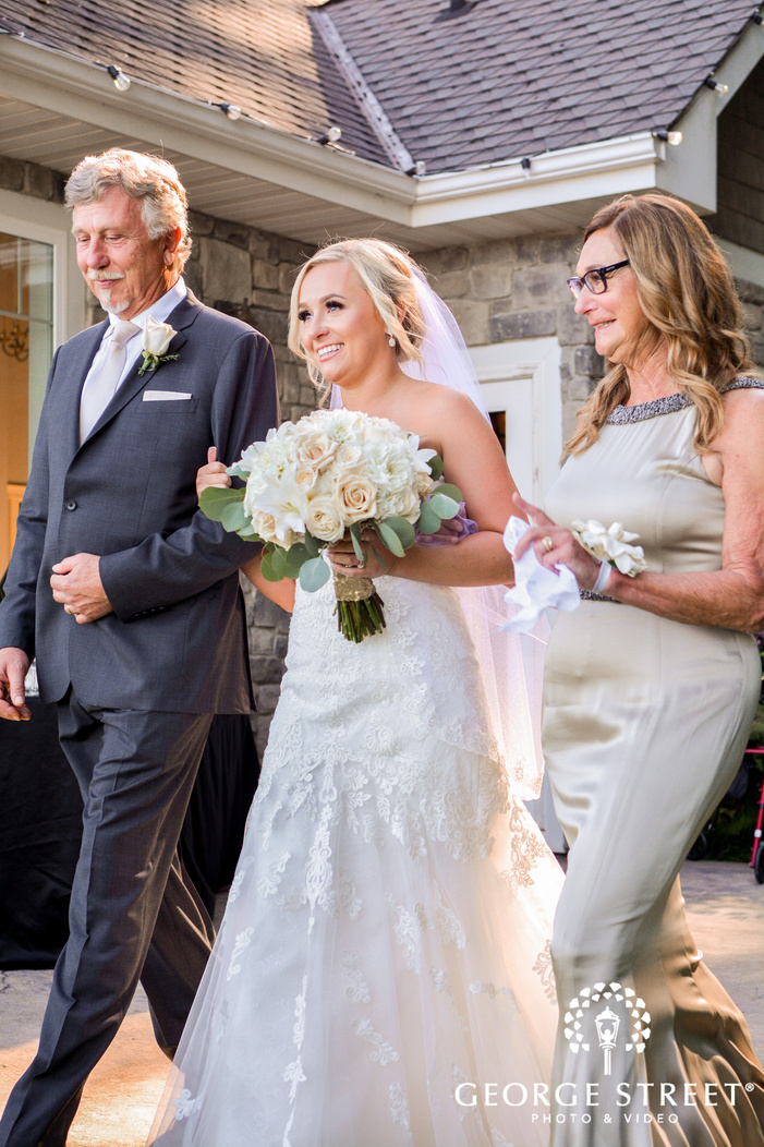 lovely bride and parents at ceremony entrance