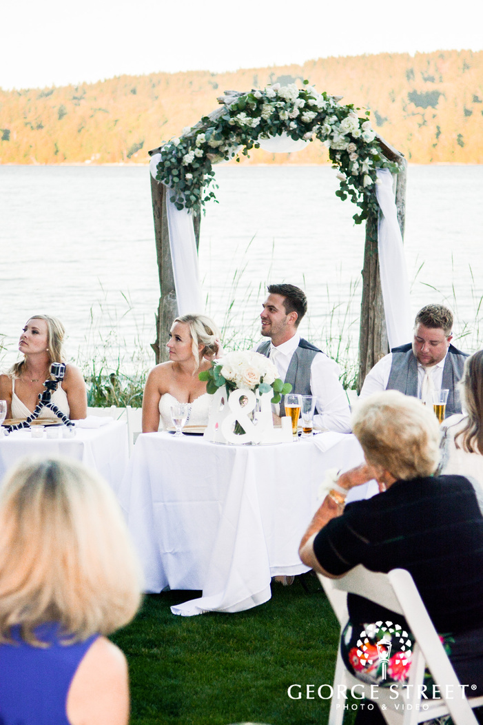 passionate bride and groom at reception