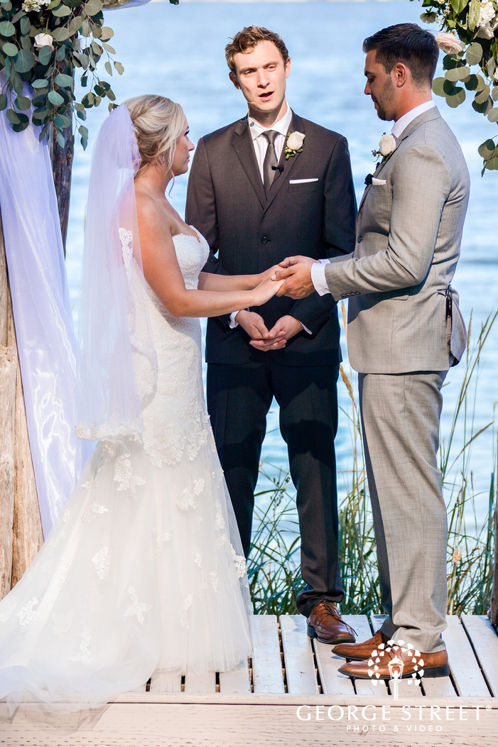 passionate bride and groom at wedding ceremony