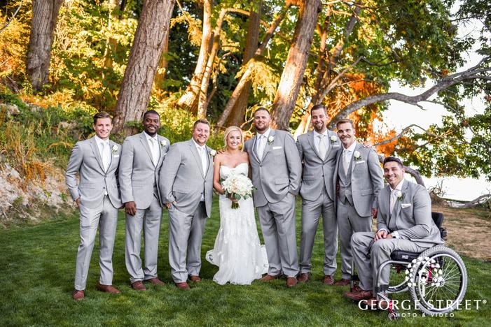 pretty bride and groomsmen in yard