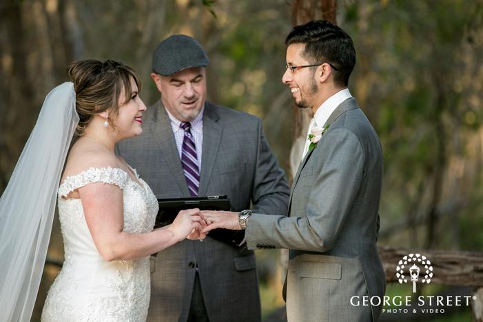 beautiful bride and groom ring exchange ceremony wedding photo