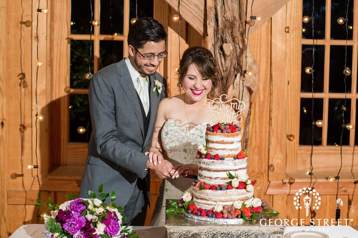 cute bride and groom cake cutting wedding photo