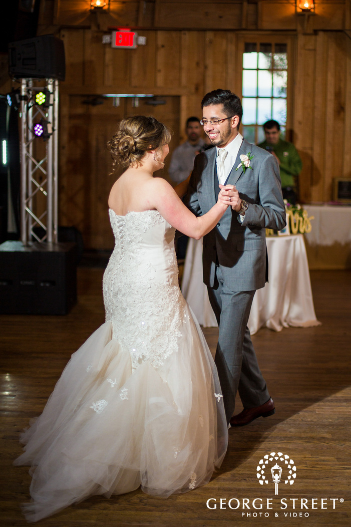 excited bride and groom first dance in reception wedding photography