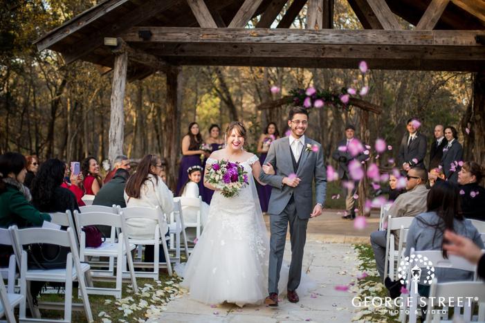 happy bride and groom on ceremony exit wedding photography