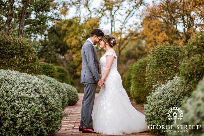 happy bride and groom on walkway wedding photography