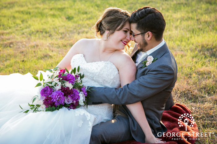 lovely bride and groom posing near venue wedding photo
