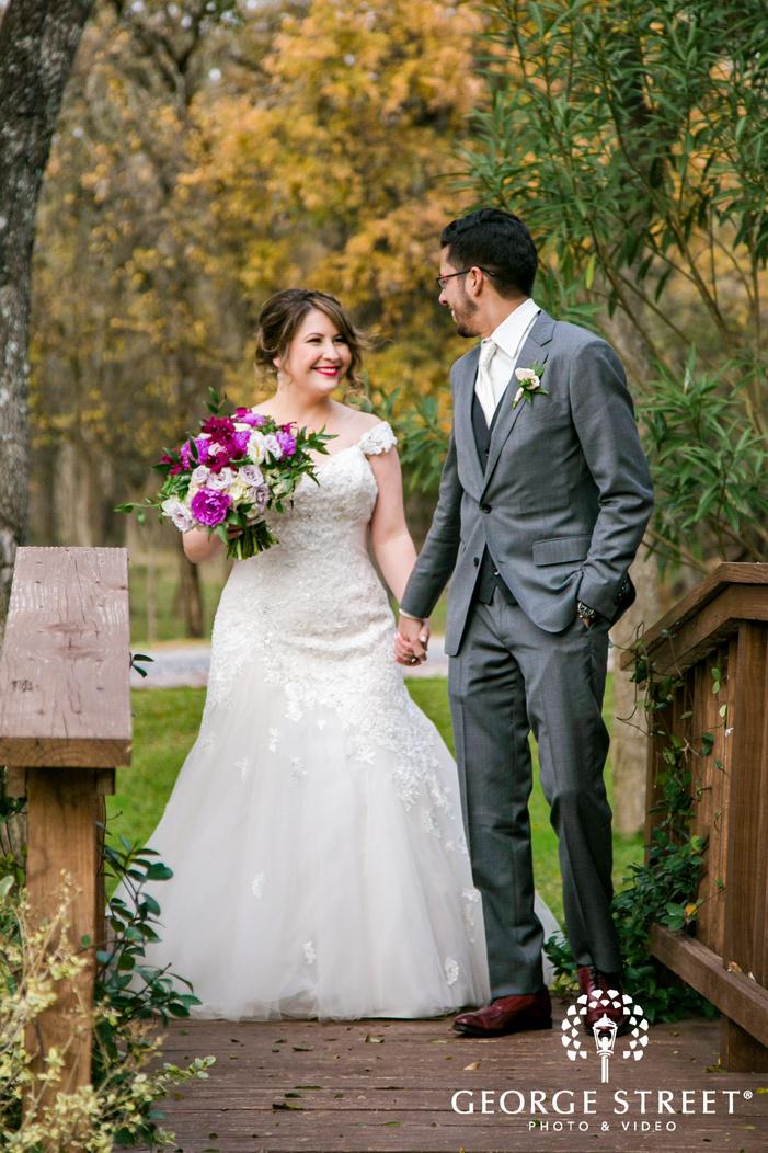 pretty bride and groom on wooden bridge wedding photo