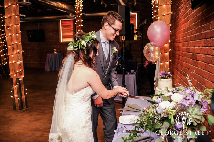 adorable bride and groom cake cutting wedding photography
