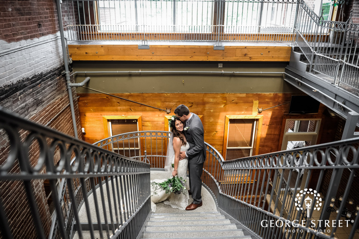 beautiful bride and groom on antique staircase wedding photography