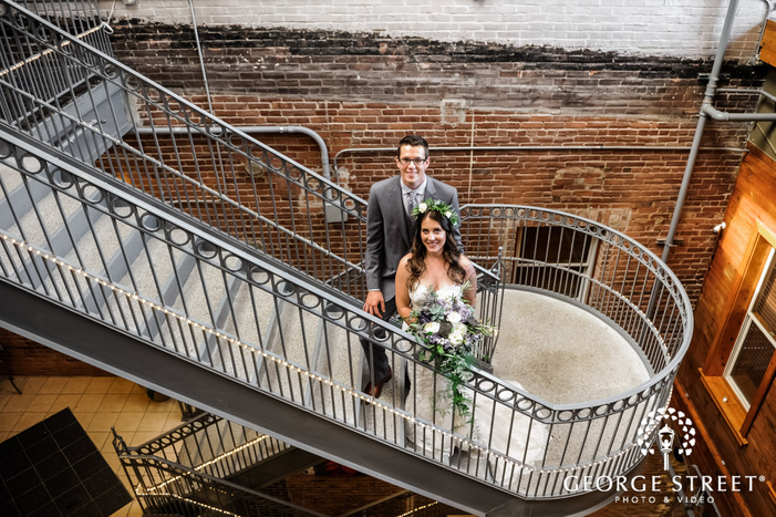 beautiful bride and groom on staircase wedding photography
