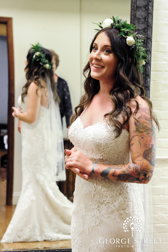 beautiful bride with cute smile in room wedding photo