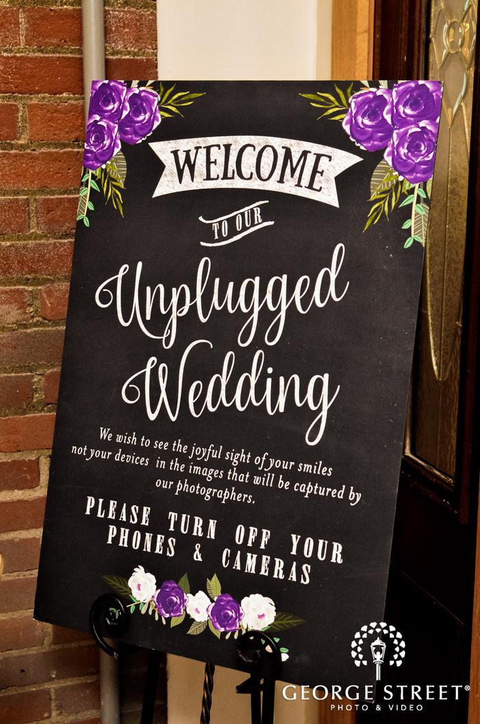 classic ceremony welcome board wedding photo