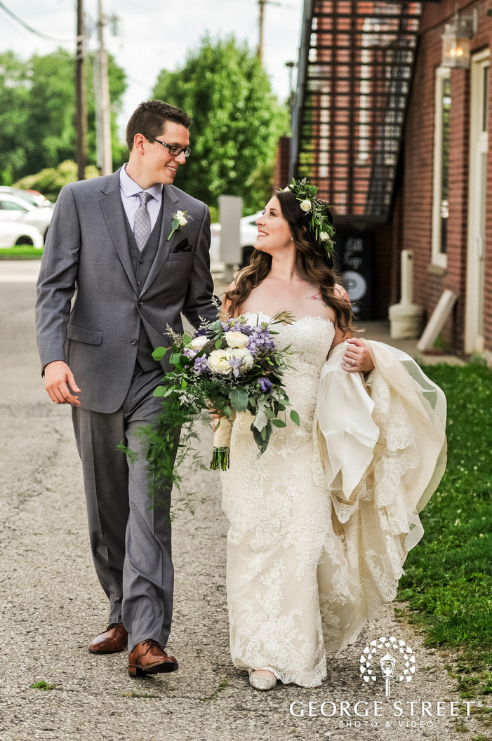 loving bride and groom on walkway wedding photo