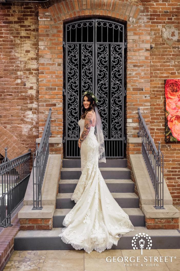 pretty bride on steps wedding photo