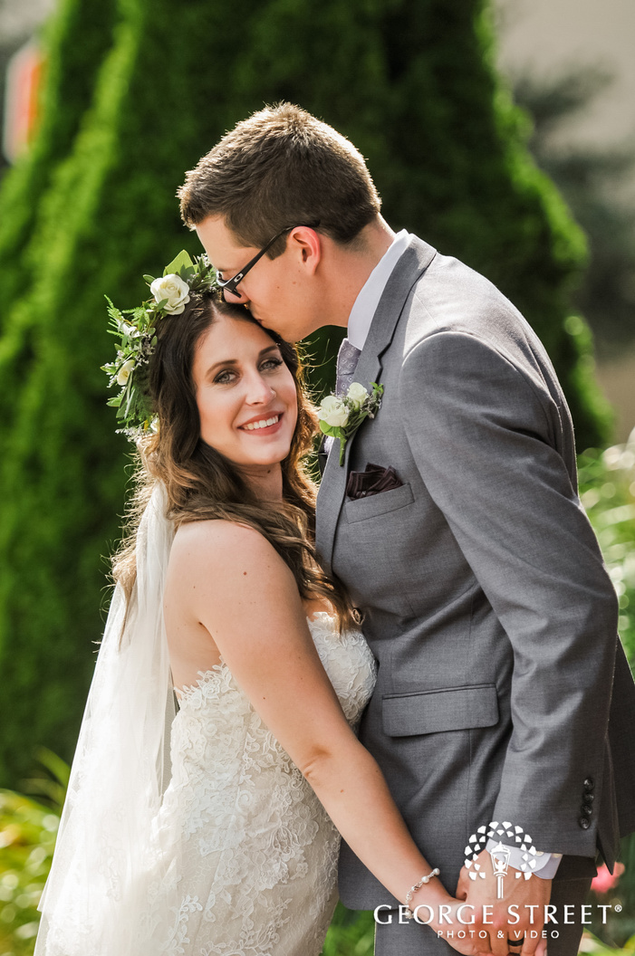 romantic bride and groom in green meadows wedding photo