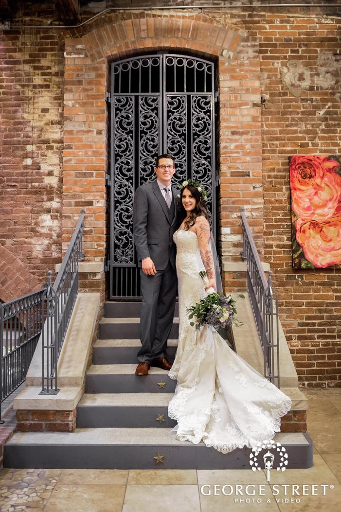 sweet bride and groom in front of vintage door wedding photography