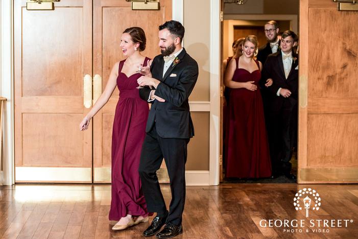 happy bridesmaid and groomsman reception entrance wedding photo
