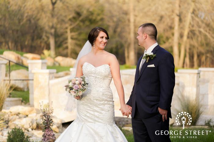 bride and groom holdiing hands outdoor portrait