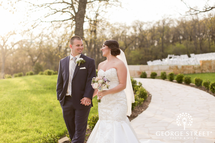 bride and groom smiling at each other gorgeous outdoor portrait
