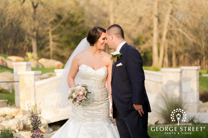 bride and groom touching foreheads outdoor portrait