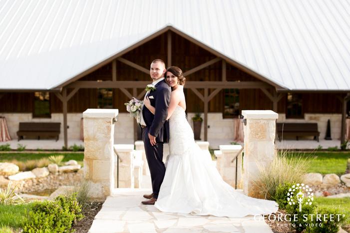 bride holding onto groom wedding portrait