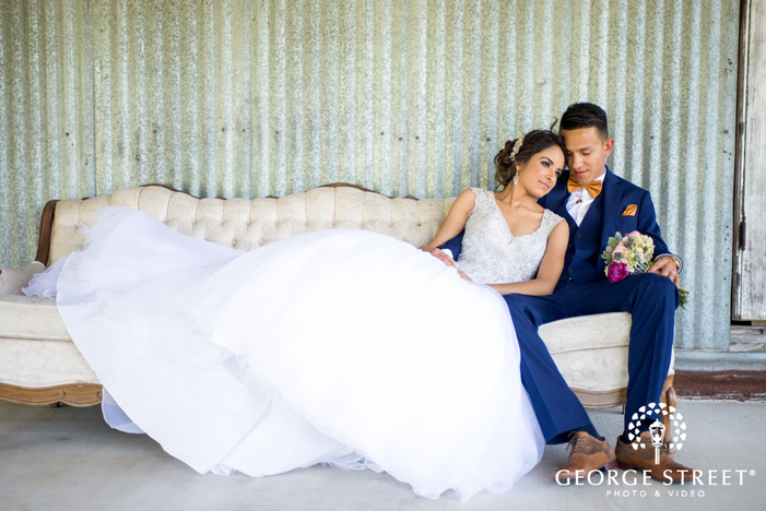 pecan springs ranch austin beautiful sunny outdoor bride and groom bench portraits
