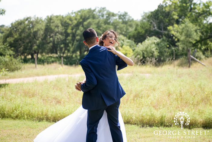 pecan springs ranch austin beautiful sunny outdoor bride and groom candid portraits