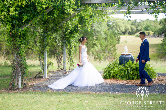 pecan springs ranch austin beautiful sunny outdoor bride and groom first look portraits