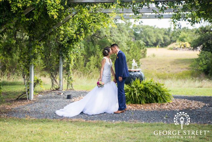 pecan springs ranch austin beautiful sunny outdoor bride and groom portraits