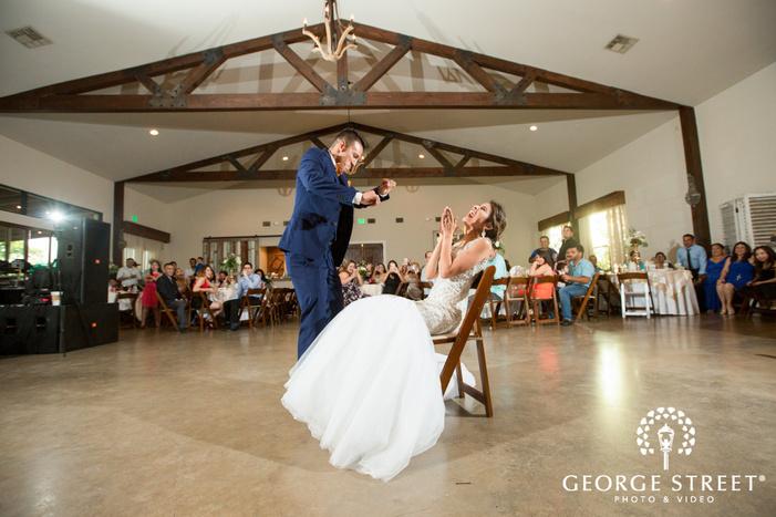 pecan springs ranch austin wedding reception bride and groom candid dance floor